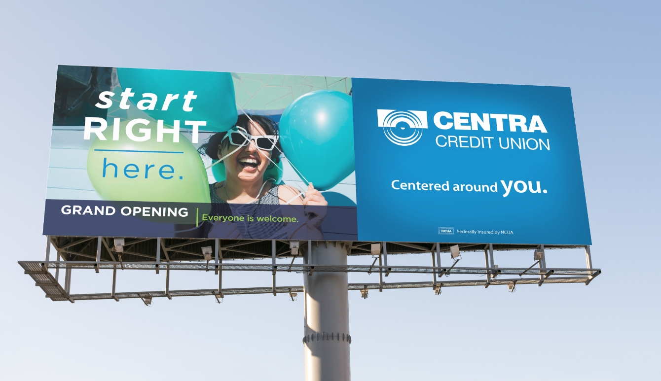 Centra Credit Union advertisement on billboard featuring woman with balloons.