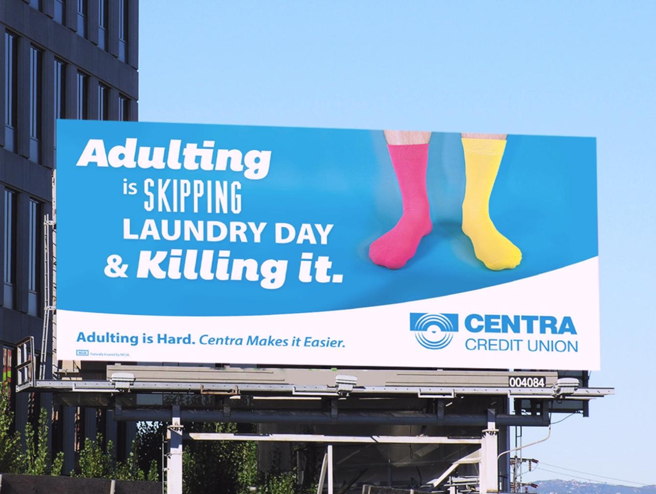 Centra Credit Union billboard near building featuring socks.